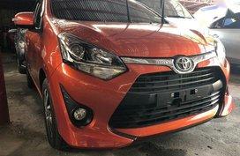 Orange Toyota Wigo 2017 for sale in Quezon City