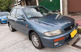 Blue Mazda Familia 1996 for sale in Quezon City
