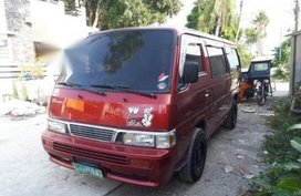 Red Nissan Urvan 2010 for sale in Pagsanjan