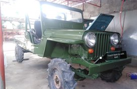 Green 1994 Jeep Willys Truck in Baler