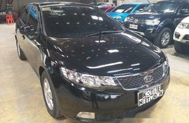 Selling Black Kia Forte 2013 Automatic Gasoline in Quezon City