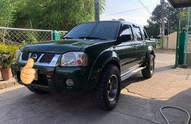Green Nissan Frontier 2004 at 100000 km for sale