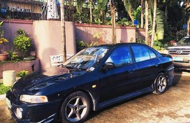Selling Blue Mitsubishi Lancer 1999 in Quezon City