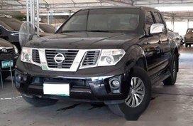 Black Nissan Frontier Navara 2013 at 70000 km for sale