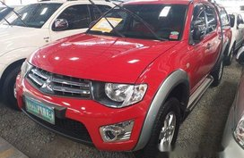 Red Mitsubishi Strada 2013 at 79025 km for sale in Quezon City