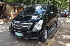 Black Hyundai Grand Starex 2011 at 80000 km for sale