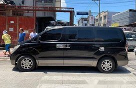 Black Hyundai Grand Starex 2011 at 85000 km for sale