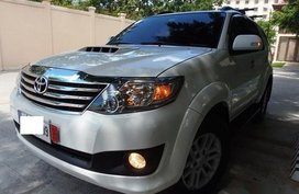 Selling White Toyota Fortuner 2014 Automatic Gasoline in Manila