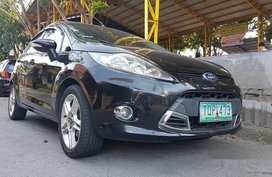 Black Ford Fiesta 2012 at 85000 km for sale