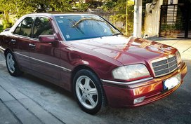 Selling Red Mercedes-Benz C220 1996 Sedan at 115000 km