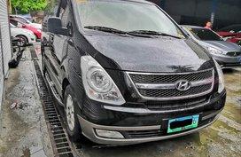 Black 2013 Hyundai Grand Starex at 60000 km for sale