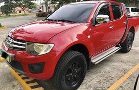 Selling Red Mitsubishi Strada 2010 Manual Diesel in Taal