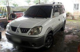 Selling White Mitsubishi Adventure 2005 at 82000 km in Davao City