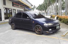 Blue Mazda 323 1997 for sale in Laguna