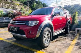 Sell Red 2013 Mitsubishi Strada at 113000 km