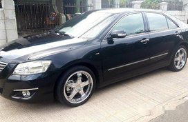Selling Black Toyota Camry 2007 at 150000 km