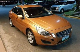 Orange Volvo S60 2011 Automatic Gasoline for sale