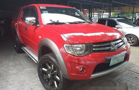 Red Mitsubishi Strada 2011 at 67256 km for sale