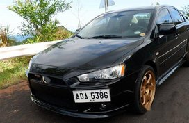 Selling Black Mitsubishi Lancer Ex 2014 Automatic Gasoline at 49000 km