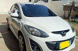 White Mazda 2 2011 at 74000 km for sale