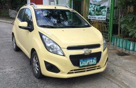 Yellow Chevrolet Spark 2013 Hatchback for sale in Manila