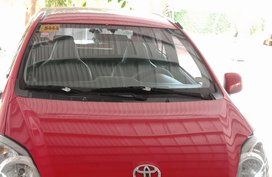 Red Toyota Wigo 2015 Hatchback for sale in Batangas