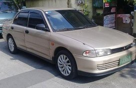 Beige Mitsubishi Lancer 1993 Manual Gasoline for sale