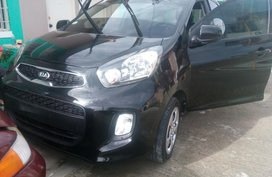 Black Kia Picanto 2016 at 25000 km for sale in Tanza