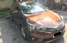 Brown Toyota Corolla 2014 for sale in Quezon City