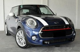 Selling Blue Mini Cooper 2015 at 18000 km