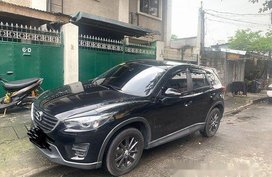 Black Mazda Cx-5 2016 at 32000 km for sale