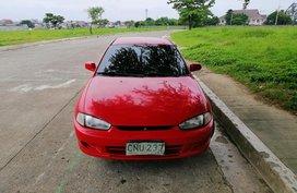 Red 1997 Mitsubishi Lancer at 120000 km for sale