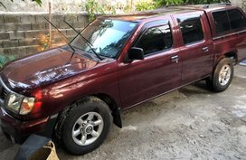 Red Nissan Frontier 2013 at 62000 km for sale