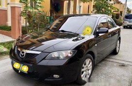 Black Mazda 3 2010 at 100000 km for sale