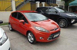 Selling Orange Ford Fiesta 2011 at 72000 km