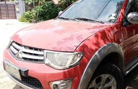 Selling Red Mitsubishi Strada 2012 at 60000 km
