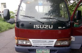 Selling Red Isuzu Elf 2009 Truck in Cavite