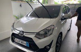 Selling White Toyota Wigo 2019 in Quezon City