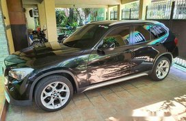 Selling Black Bmw X1 2011 at 20000 km