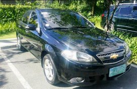 Black Chevrolet Optra 2008 at 70000 km for sale