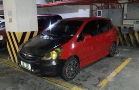 Red Honda Fit 2008 at 95000 km for sale