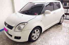 White Suzuki Swift 2010 at 61817 km for sale