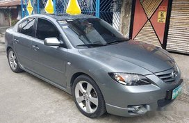 Selling Grey Mazda 323 2006 at 65000 km