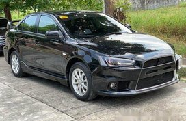 Selling Black Mitsubishi Lancer Ex 2014 at 21916 km