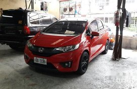 Red Honda Jazz 2015 at 35000 km for sale