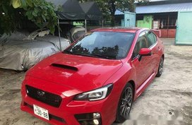 Red Subaru Wrx 2015 at 21000 km for sale