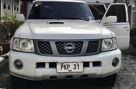White Nissan Patrol 2013 at 157000 km for sale