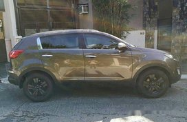 Selling Brown Kia Sportage 2012 Automatic Gasoline at 68000 km