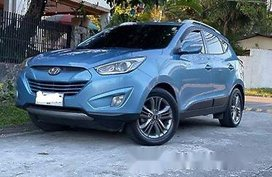 Selling Blue Hyundai Tucson 2014 at 100000 km
