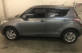 Selling Grey 2015 Suzuki Swift ịn Mandaluyong